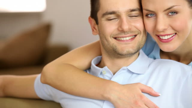 HD Couple at home, smiling, embracing