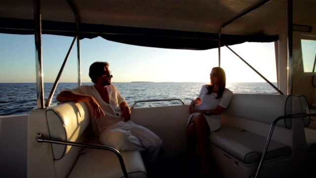 couple at sunset on a boat trip