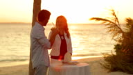 couple at sunset with cocktails