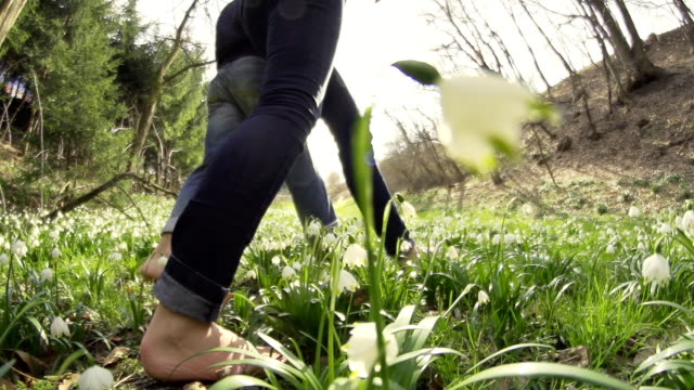 HD SUPER SLOW-MO: Couple Barefoot Walking In The Grass