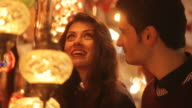 Couple buying turkish lamps