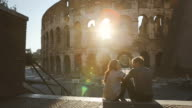 Couple by the Coliseum at sunset