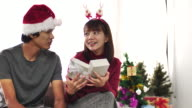 Couple celebrate Christmas and giving gift in Christmas Event