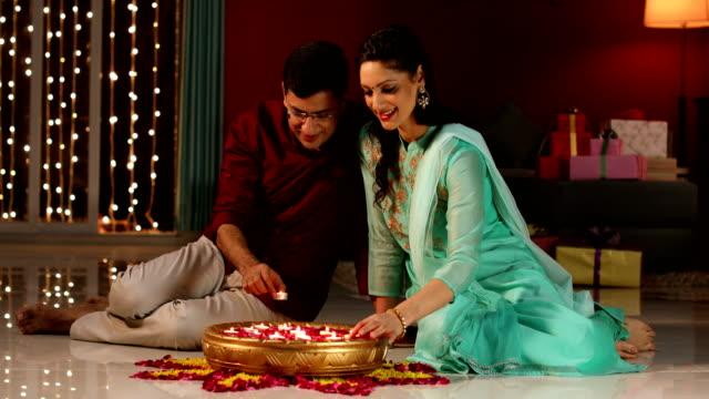 Couple celebrating diwali festival, Delhi, India