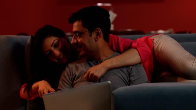 Couple chatting on laptop, Delhi, India