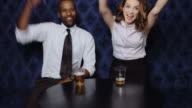 Couple Cheering in Bar