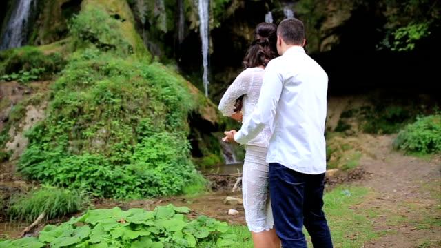 Couple Dancing By Waterfall