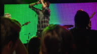 MS TD SLO MO Couple dancing in nightclub at rock concert / London, UK
