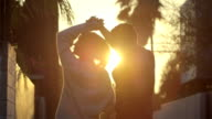 couple dancing in sun flares