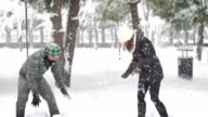 Couple Doing Snowball Fight