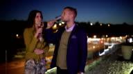 Couple drinking wine on terrace