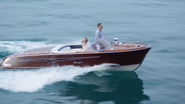 Couple driving on yacht