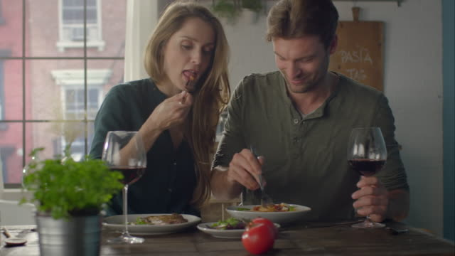 Couple eating self-made food in the kitchen