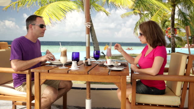 couple enjoying lunch at poolside