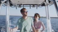 MS Couple enjoying themselves on motorboat / Charleston, South Carolina, USA