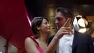 SLO MO MS LA Couple entering restaurant and kissing, Rome, Lazio, Italy