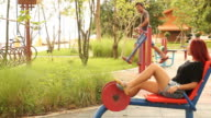 Couple exercise at the park