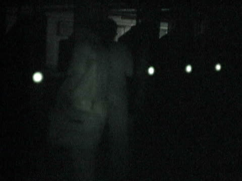 Couple exiting subway tunnel through turnstile and walking outside during citywide blackout on August 14 2003 / New York New York USA / AUDIO
