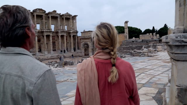Couple explore ruins of ancient Greek civilization