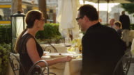 MS Couple feeding each other and toasting with red wine in outdoors restaurant / Venice,Veneto