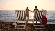 SLO MO Couple going to swim in the sea