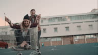 Couple haveing fun with shopping cart
