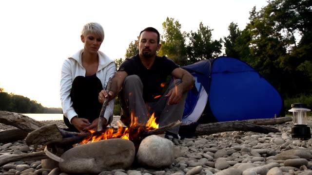HD SUPER SLOW-MO: Couple Having A Campfire