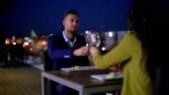 Couple having dinner on balcony
