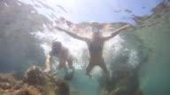 HD: Couple Having Fun In The Sea