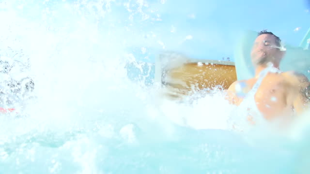 HD SUPER SLOW-MO: Couple Having Fun On Water Slide