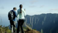 Couple hiking in Hawaii's Na Pali Coast