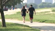 WGN Couple Holding Hands Walking With Small Child on Labor Day Weekend in Chicago on September 5 2015