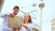 Couple holding map and discussing
