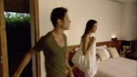 MS PAN WS Couple hotel room and looking at view, Hua Hin, Prachuap Khiri Khan, Thailand