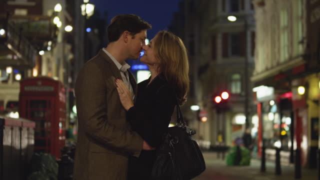 MS TU Couple in downtown at night / Soho, London, UK