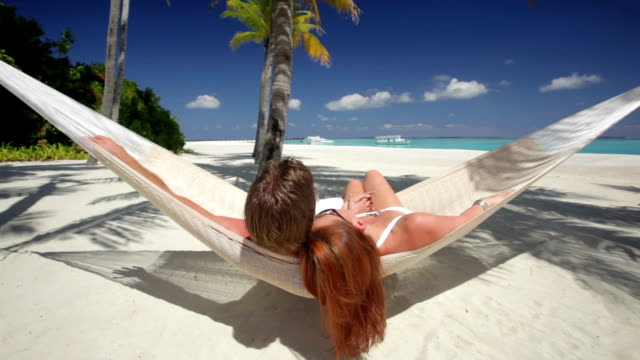 couple in hammock on tropical island