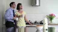 Couple in kitchen at breakfast time