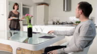 Couple in kitchen having meal