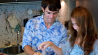 Couple in kitchen together prepare meal
