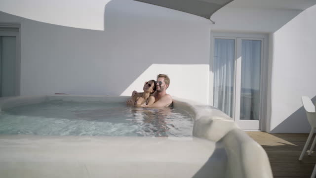 Couple in luxury private pool