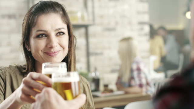 Couple in the restaurant drinking beer
