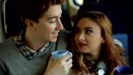 Couple in train drinking tea