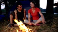 Couple is talking and bonding by the fire