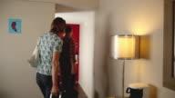 MS Couple leaving hotel apartment / Los Angeles, California, USA