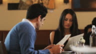 couple looking at menus in a restaurant