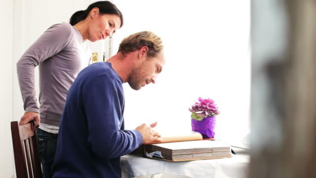Couple looking at photgraph album