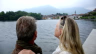 POV of couple looking out across lake to village behind