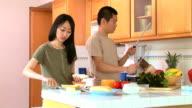 Couple making sandwiches