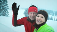 Couple making video call from the cross country skiing track