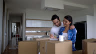 Couple moving into their new flat